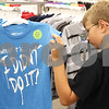 Kyle Bursaw – kbursaw@daily-chronicle.com<br /> <br /> Noah Hansen, 10, investigates a shirt while shopping at Target on an $85 gift card from the Salvation Army in DeKalb, Ill. on Tuesday, July 26, 2011.