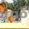 Kyle Bursaw – kbursaw@daily-chronicle.com<br /> <br /> Natalie Rosenow, 7, picks up two lemonades from the Alex's Lemonade Stand in front of BabyKids First Learning Years Center in Sycamore, Ill. on Tuesday, Aug. 9, 2011.