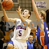 Rob Winner – rwinner@shawmedia.com<br /> <br /> Hinckley-Big Rock's Bernie Conley puts up two after a steal as Genoa-Kingston's Eli Thurlby trails during the second quarter in Hinckley, Ill., on Monday, Dec. 19, 2011. H-BR defeated G-K, 58-40.