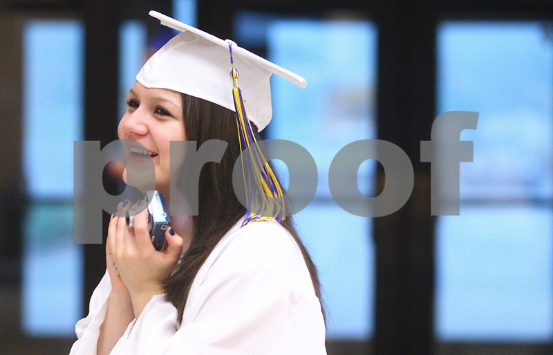 Kyle Bursaw – kbursaw@daily-chronicle.com<br /> <br /> Larissa Quezada smiles after previewing a photo of her with fellow seniors on her camera before the Somonauk Community High School graduation on Sunday, May 29, 2011.