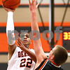 Kyle Bursaw – kbursaw@shawmedia.com<br /> <br /> DeKalb center Andre Harris shoots while Winnebago's Ryan Swigart defends<br /> during the first half of the game in the Chuck Dayton Holiday Tournament in DeKalb, Ill. on Thursday, Dec. 22, 2011. DeKalb defeated Winnebago 46-36.