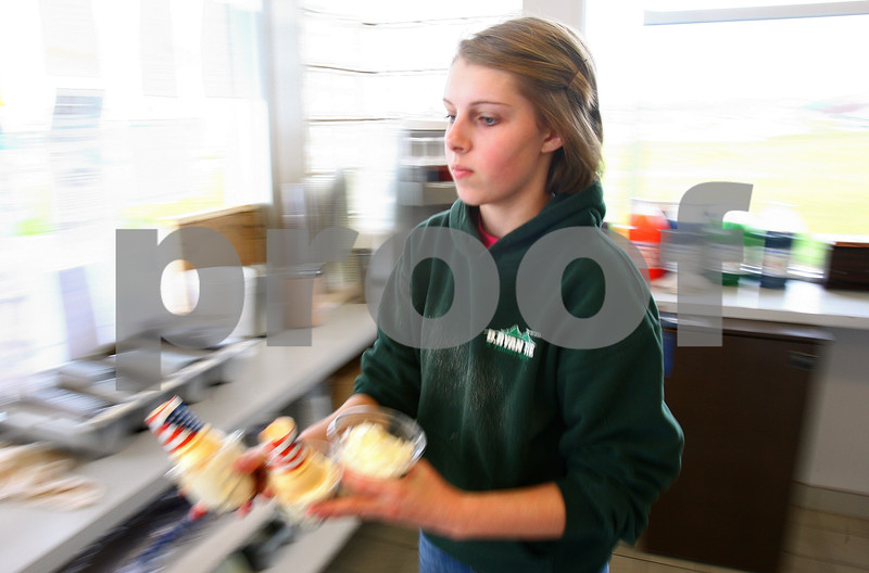 Kyle Bursaw – kbursaw@daily-chronicle.com<br /> <br /> Abbey Hartwig, 17, hustles an order to the window at Ollie's Frozen Custard in Sycamore, Ill. on Friday, May 6, 2011.