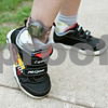 Rob Winner – rwinner@daily-chronicle.com<br /> <br /> Nolan Finn, 6, who is at risk for wandering, wears a tracking device on his right leg as part of the Care Trak program.