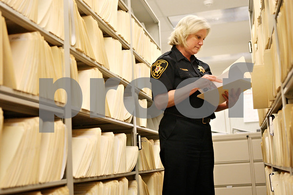 Rob Winner – rwinner@daily-chronicle.com<br /> <br /> Records clerk Karin Strausberger, an administrative assistant of the DeKalb County Sheriff's Office, looks over a files on Monday afternoon in Sycamore.