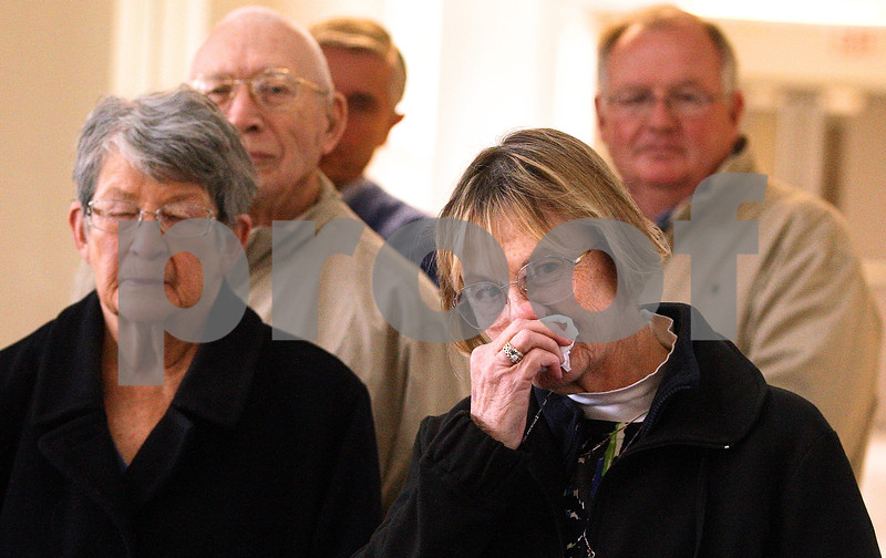 Kyle Bursaw – kbursaw@daily-chronicle.com<br /> <br /> Mary Simons wipes as people share stories about Pat LaVigne's life during a dedication ceremony for a white oak tree that will be planted by the DeKalb Nursing Home Grounds.<br /> <br /> Friday, April 22, 2011.
