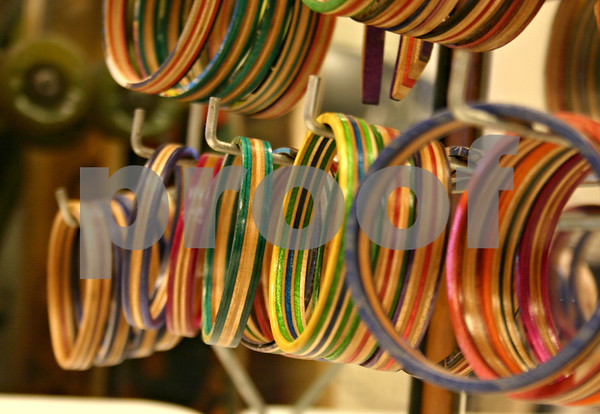 Ariel Ries, owner of Smalltown Skateboard Shop in DeKalb, is launching her new line of jewelry made from broken skateboards. Pictured are bangle bracelets Ries made by hand.<br /> <br /> By NICOLE WESKERNA - nweskerna@shawmedia.com