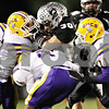 Rob Winner – rwinner@shawmedia.com<br /> <br /> Kaneland's Jesse Balluff (30) is stopped by a swarm of Belvidere defenders during the first quarter in Maple Park on Friday, Oct. 28, 2011.
