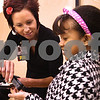 Kyle Bursaw – kbursaw@daily-chronicle.com<br /> <br /> Lisa Cumings, a community health liason at Kishwaukee Hospital, hands out a jicama stick to fourth-grader Jasmine Jackson during lunch period at Tyler Elementary on Wednesday, April 20, 2011, the first day a new fruit and vegetable cart was available.