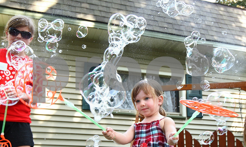 Kyle Bursaw – kbursaw@daily-chronicle.com<br /> <br /> Kate Wilska, 3, uses a pair of bubble wands to create a flurry of bubbles during Meet me at the Fair, a fundraiser for the Pay-It-Forward House in Sycamore, Ill. on Saturday, July 16, 2011.