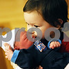 Rob Winner – rwinner@daily-chronicle.com<br /> <br /> Landon Cagle, 2, kisses his newborn baby brother Hunter Cagle at Kishwaukee Community Hospital in DeKalb, Ill. on Saturday, January 1, 2011. Hunter was born at 5:27 a.m. New Year's Day and is the first baby born in DeKalb county this year.