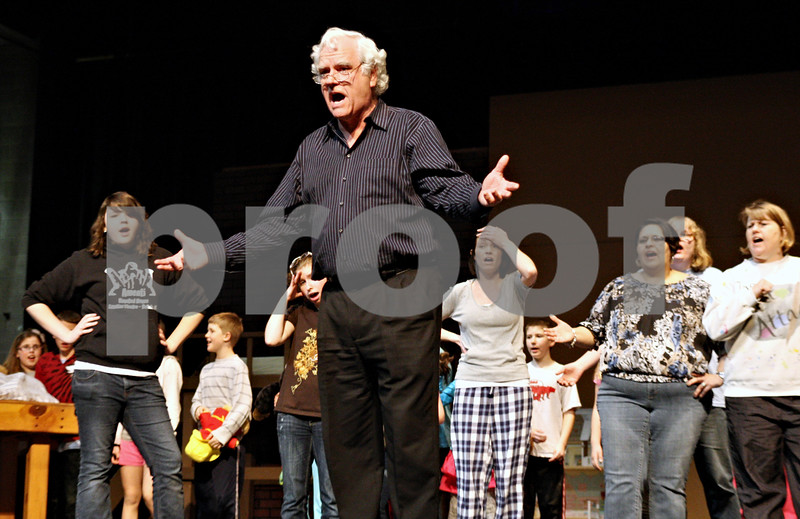 Rob Winner – rwinner@daily-chronicle.com<br /> <br /> George Schippits, who is playing Geppetto in Disney's My Son Pinocchio, rehearses with cast members of the Children's Community Theatre on Monday night at the O'Connell Theatre in the Stevens Building at Northern Illinois University in DeKalb.