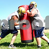 Kyle Bursaw – kbursaw@daily-chronicle.com<br /> <br /> A pair of Hiawatha players work on a drill during morning football practice on Thursday, Aug. 11, 2011.