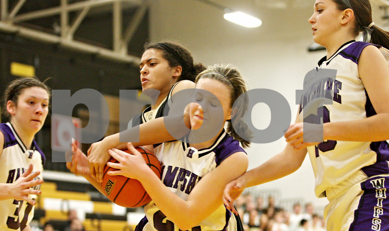 Rob Winner – rwinner@daily-chronicle.com<br /> <br /> Hampshire's Karla Vietinghoff (front) and Sycamore's Olivia Rand struggle for control of a loose ball under the Spartans' basket during the first quarter in Sycamore, Ill.,  on Wednesday, Feb. 16, 2011. Hampshire would go on to defeat Sycamore, 57-41, during the IHSA Class 3A Sycamore Regional.