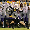 Rob Winner – rwinner@shawmedia.com<br /> <br /> Belvidere's Marcus Gooden (19) is hit by Kaneland's Tanner Andrews during a pass attempt in the second quarter of their game in Maple Park on Friday, Oct. 28, 2011.