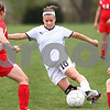 Kyle Bursaw – kbursaw@daily-chronicle.com<br /> <br /> Michelle Doran changes direction as Ottawa players close in on her during the first half. Sycamore defeated Ottawa 6-0 at Sycamore high school on Saturday, May 7, 2011.