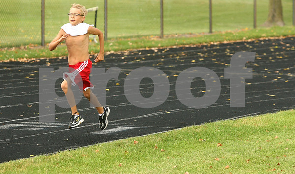 Kyle Bursaw – kbursaw@daily-chronicle.com<br /> <br /> Dylan Kvapil, 10, rounds the final curve of a 400-meter run during Huskie Track Club practice at the old DeKalb High School on Thursday, July 7, 2011. Ten-year-old Kvapil will attempt to qualify for the USATF national meet in the 1,500-meter run.