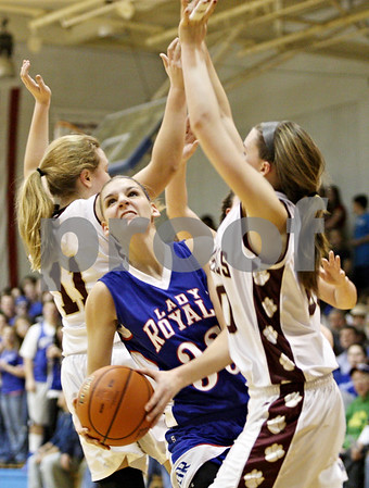 Rob Winner – rwinner@daily-chronicle.com<br /> <br /> Hinckley-Big Rock's Tess Godhardt looks to shoot between two St. Benedict defenders during the second quarter of the IHSA Class 1A H-BR Sectional final in Hinckley, Ill., on Thursday February 17, 2011. Hinckley-Big Rock went on to defeat St. Benedict, 63-25.