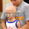 Kyle Bursaw – kbursaw@daily-chronicle.com<br /> <br /> David Schmitt, 12, pumps to dislodge an object from the airway of a doll while practicing  the skills to help choking victims during a babysitting class at Kishwaukee Hospital on Wednesday, July 20, 2011.
