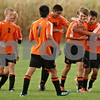 Rob Winner – rwinner@shawmedia.com<br /> <br /> Trevor Freeland's (21) DeKalb teammates congratulate him after his second goal during the first half in Maple Park on Thursday, Sept. 29, 2011. DeKalb defeated Kaneland, 2-0.