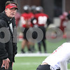 Kyle Bursaw – kbursaw@daily-chronicle.com<br /> <br /> Wide Receivers coach Bob Cole leads a drill during practice at Huskie Stadium on Tuesday, March 22, 2011.