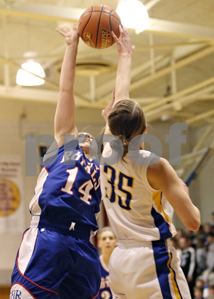 Rob Winner – rwinner@daily-chronicle.com<br /> <br /> Hinckley-Big Rock's Kaitlin Phillips (14) has her shot blocked by Somonauk's Lauren Brummel during the first quarter of the IHSA Class 1A Sectional game in Hinckley, Ill., on Monday February 14, 2011.