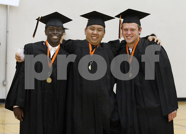 Wendy Kemp - For The Daily Chronicle<br /> <br /> (From left) Thomas Ogundipe, Brandon Pham and Trevor Kahl stand together before the DeKalb High School graduation ceremony at the Convocation Center at Northern Illinois University on Saturday.
