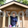 Kyle Bursaw – kbursaw@shawmedia.com<br /> <br /> Jason Nicol paints the front of one of the Opportunity House locations in DeKalb, Ill. on Thursday, Sept. 8, 2011, while volunteering on the Day of Caring sponsored by the Kishwaukee United Way.