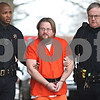 Kyle Bursaw – kbursaw@daily-chronicle.com<br /> <br /> William Curl is escorted into one of the back doors to the DeKalb County Courthouse in Sycamore, Ill. on Tuesday, Feb. 22, 2011.