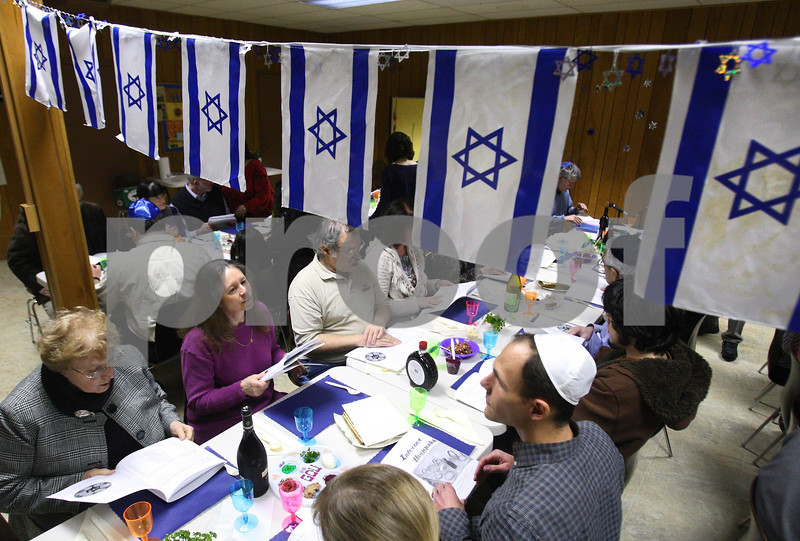 Kyle Bursaw – kbursaw@daily-chronicle.com<br /> <br /> About forty people take part in a Passover Seder at Congregation Beth Shalom in DeKalb, Ill. on Tuesday, April 19, 2011,