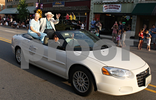 Rob Winner – rwinner@daily-chronicle.com<br /> <br /> Barry Schrader and his wife wave during the Kishwaukee Fest Parade on Friday, July 29, 2011.