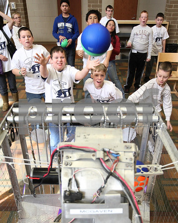 Kyle Bursaw – kbursaw@daily-chronicle.com<br /> <br /> Dylan Beck (front left) prepares to catch a ball headed for him. The ball was launched by a robot in the 'FIRST robotics' session in the library of Cortland Elementary during the Students Involved with Technology conference in Cortland, Ill. on Saturday, Feb. 12, 2011.
