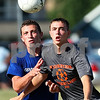 Kyle Bursaw – kbursaw@daily-chronicle.com<br /> <br /> A DeKalb player and Burlington Central player chase after the ball during the first half at Huntley Middle School on Friday, July 22, 2011.