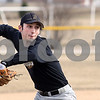 Kyle Bursaw – kbursaw@daily-chronicle.com<br /> <br /> Sycamore senior Trevor Mathey throws a ball he fielded at third base while doing drills at baseball practice on Wednesday, March 16, 2011.