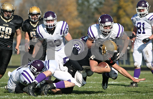Rob Winner – rwinner@shawmedia.com<br /> <br /> Sycamore quarterback Ryan Bartels carries the ball during the second quarter of a Class 5A playoff game in Sycamore, Ill., on Saturday, Nov. 5, 2011. Rochelle defeated Sycamore, 21-16.