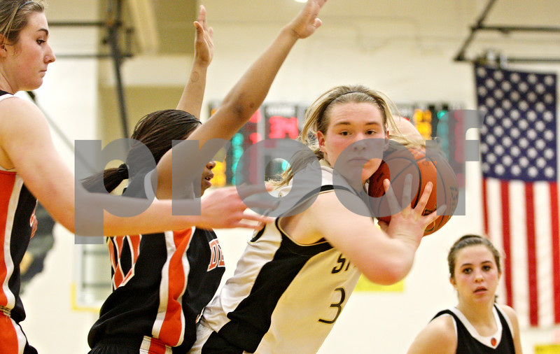 Rob Winner – rwinner@daily-chronicle.com<br /> <br /> Sycamore's Jessica Pluhm controls a DeKalb rebound as time expires on Thursday, Feb. 10, 2011 in Sycamore, Ill. Sycamore went on to defeat DeKalb, 34-30.