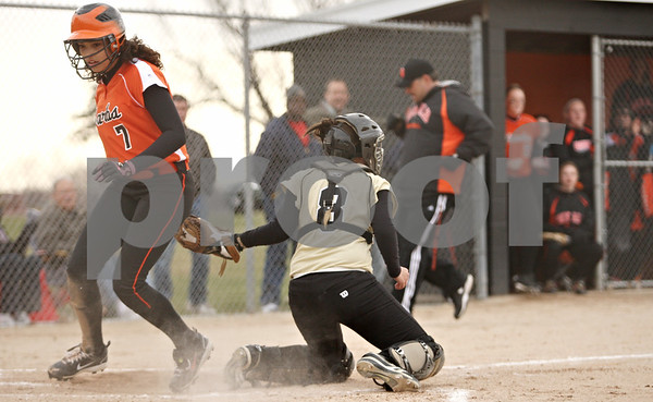 Rob Winner – rwinner@daily-chronicle.com<br /> <br /> DeKalb's Jessica Townsend (7) scores before a tag is applied by Sycamore's Samantha Navarro (8) during the second inning on Tuesday, April 5, 2011, in DeKalb, Ill. DeKalb defeated Sycamore, 4-3.