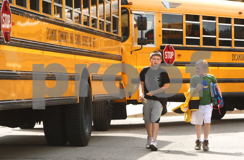 Kyle Bursaw – kbursaw@daily-chronicle.com<br /> <br /> North Grove Elementary students Gage (left) and Brody Armstrong transfer buses after school at Sycamore High School on Thursday, May 19, 2011.