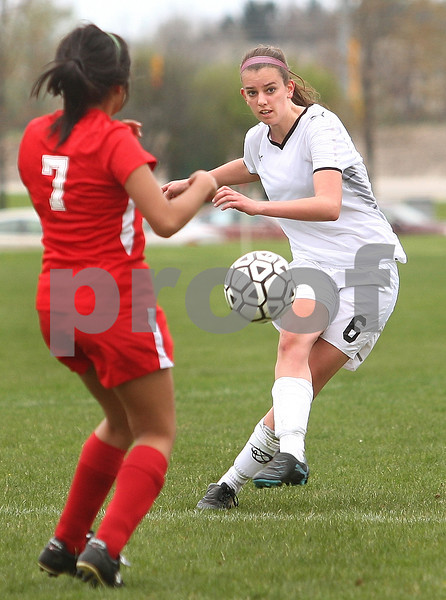 Kyle Bursaw – kbursaw@daily-chronicle.com<br /> <br /> Sycamore's Alyssa Hepker takes a shot past Ottawa's Angie Bedolla in the first half. Sycamore defeated Ottawa 6-0 at Sycamore high school on Saturday, May 7, 2011.