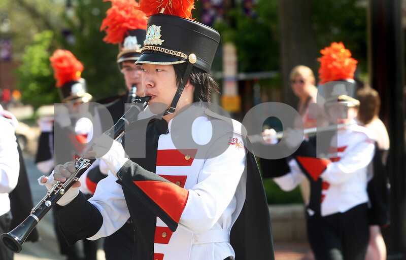 Kyle Bursaw – kbursaw@daily-chronicle.com<br /> <br /> A clarinet player for the DeKalb High School marching band proceeds with the parade down East Lincoln Highway in DeKalb, Ill. on Monday, May 30, 2011.