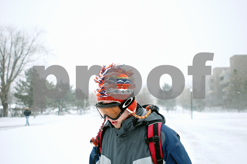 Rob Winner – rwinner@daily-chronicle.com<br /> <br /> Northern Illinois University student Travis Harrell heads back to his dorm after learning his class was canceled on Tuesday afternoon.