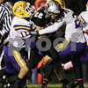 Rob Winner – rwinner@shawmedia.com<br /> <br /> Kaneland's Quinn Buschbacher (22) carries the ball near the Belvidere goal line after a reception during the first quarter in Maple Park on Friday, Oct. 28, 2011.