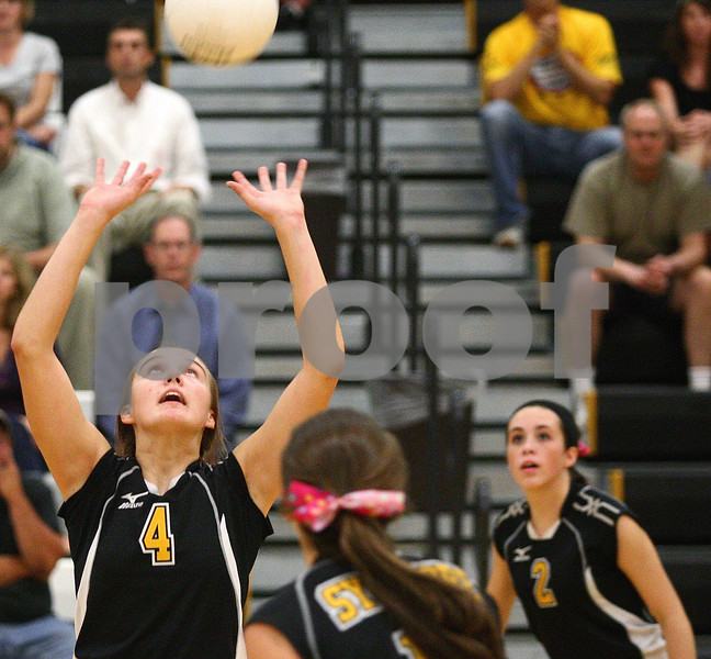 Kyle Bursaw – kbursaw@shawmedia.com<br /> <br /> Sycamore's Natasha Garbes sets the ball during the match against Kaneland in Sycamore, Ill. on Tuesday, Sept. 20, 2011.