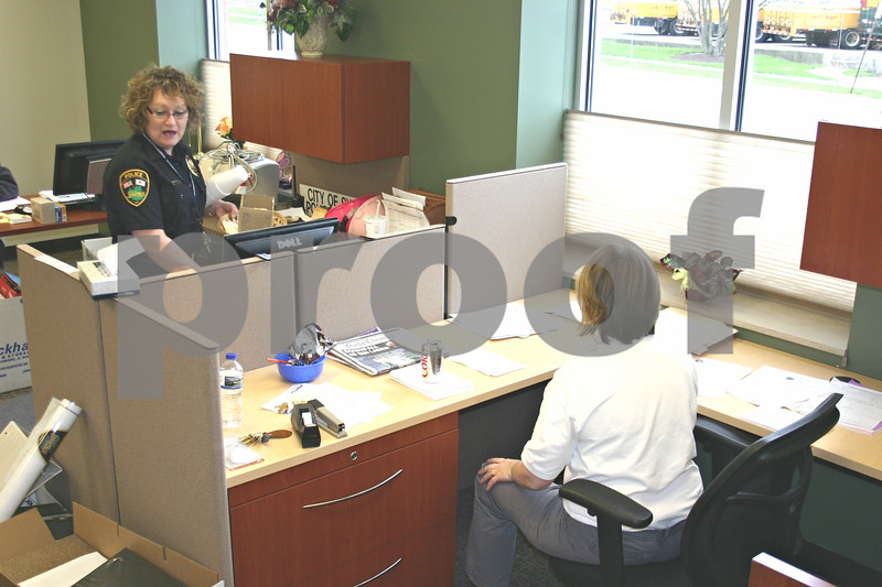 Administrative Secretary Colleen Ziegler, left, and records clerk Megan Petit get situated in their new office Tuesday afternoon after the Sycamore Police Department opened its new, expanded building.