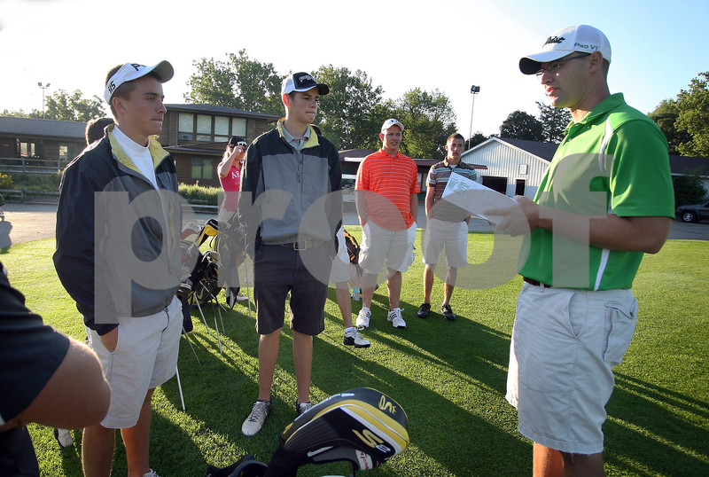 Wendy Kemp - For The Daily Chronicle<br /> Sycamore golf coach, David Burdick (right), talks with the varsity team before practice at the Sycamore Golf Club on Thursday.<br /> Sycamore 8/11/11