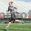 Rob Winner – rwinner@daily-chronicle.com<br /> <br /> Jenna Thorp, along with her Northern Illinois basketball teammates, run on the Huskie Stadium turf while conditioning in DeKalb on Wednesday, July 13, 2011.