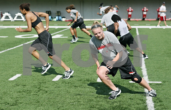 Rob Winner – rwinner@daily-chronicle.com<br /> <br /> Jenna Thorp (front), along with her Northern Illinois basketball teammates, run on the Huskie Stadium turf while conditioning in DeKalb on Wednesday, July 13, 2011.