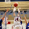 Rob Winner – rwinner@daily-chronicle.com<br /> <br /> Genoa-Kingston's Adam Price (34) takes a shot between two Somonauk defenders during the first quarter in Genoa, Ill. on Tuesday, Jan. 25, 2011.