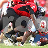 Kyle Bursaw – kbursaw@shawmedia.com<br /> <br /> Northern Illinois linebacker Jamaal Bass (6) brings down Wisconsin running back Jeffrey Lewis (22) during the fourth quarter of the game at Soldier Field in Chicago, Ill. on Saturday, September 17, 2011. Wisconsin defeated Northern Illinois 49-7.