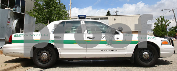 Kyle Bursaw – kbursaw@daily-chronicle.com<br /> <br /> A police car at the DeKalb Municipal building with the current decals.<br /> <br /> Wednesday, May 25, 2011.