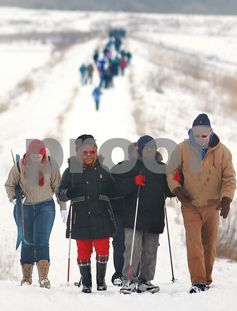 Kyle Bursaw – kbursaw@daily-chronicle.com<br /> <br /> Rick Tonozzi (far right) guides Ardella Wiggins (center left) and Lamar Lott (center right) up a slope on a trail at Shabbona Lake State Park during the Lion's annual Ski-for-Sight event. as Carole Fleetwood (far left) walks behind them on Saturday, Jan. 29, 2011.